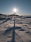 Crosses in graveyard casting shadows - Stock Image - CT1A66