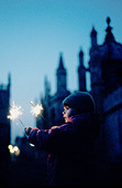 Young girl holding sparklers on Guy Fawkes Night - Stock Image - ANPR7A