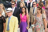 epa04408050 Pippa Middleton (C), sister of Britain's Catherine Duchess of Cambridge and her mother Carole (R) arrive for the wedding ceremony of Charlie Gilkes and Anneke von Trotha Taylor in Monopoli, Italy, 19 September 2014. British Prince Harry was also among the guests who attend the marriage.  EPA/LUCA TURI - Stock Image - E7PDGR