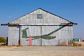 Abandoned hanger with glider logo, Kingsfield, Dhekelia, Cyprus. - Stock Image - ECYKMP