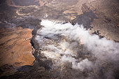 Pahoa, Hawaii, USA. 28th October, 2014. Kilauea lava flow threatens residents of Pahoa. The flow has moved within 200 yards from the nearest home. Pu'u o'o vent shown. © commercial images/Alamy Live News - Stock Image - E9JH8J