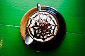 Decorative design in foam on latte - Stock Image - CPDE0B