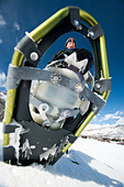 Close-up of man walking with snow shoes - Stock Image - BJTN0J