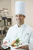 Chef presenting gourmet entree - Stock Image - B4XA24