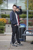 Vancouver, Canada. 27th July, 2015. Aaron Paul, famed for his role in the blockbuster Tv series Breaking Bad, filming 'Come and Find Me' movie in Vancouver, Canada today. The film is written and directed by Zack Whedon and follows the character of David (Paul) who must track down his missing girlfriend after he realizes she's not who she was pretending to be. © Robert Horsley/Alamy Live News - Stock Image - EYDAWE