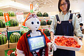 Tokyo, Japan. 1st July, 2015. The humanoid robot Pepper debuted as a new member of staff at the ''Tottori Okayama Shimbashi-kan'' store. The robot developed by SoftBank Corp. is programmed to interact with people and it is claimed that it can provide reception services in commercial establishments. Pepper will introduce the store's products and services to customers as a special employee for two days. The Tottori Okayama Shimbashi-kan sells unique food and traditional handicraft products from Tottori and Okayama prefectures in western Japan. © Rodrigo Reyes Marin/AFLO/Alamy Live News - Stock Image - EWTBYF