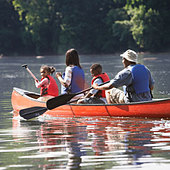 African American family in canoe - Stock Image - AY2FXK