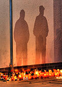 Zdar nad Sazavou, Czech Republic. 14th October, 2014. People lit candles near the high school where a woman stabbed and killed a teenager and injured two other students in Zdar nad Sazavou, 120 kilometers (75 miles) southeast of Prague. Police spokeswoman Jana Kroutilova says the victim was a 16-year old boy. She says the 26-year-old female suspect also injured two teenage girls and a police officer before she was arrested. Police say the suspect was from a different Czech region and it was not immediately clear why she attacked the students. © CTK/Alamy Live News - Stock Image - E8TRW4