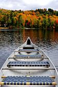 Canoe on a lake - Stock Image - B4P5J8