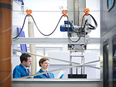 Scientists with product being processed - Stock Image - C407P5