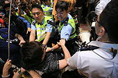 Hong Kong. 17th October, 2014. Tensions run high between pro-democracy protesters and police during a other chaotic night after police tried to clean up the area at the morning, thousands of protesters immediately surrounded them in order to take over the Mong Kok district again in Hong Kong, on 17th October 2014. © NurPhoto.com/Alamy Live News - Stock Image - E92W9Y