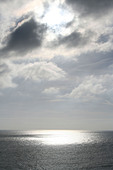 Sun breaking through clouds onto the sea off Old Harry's Rocks, Handfast Point,  The Isle of Purbeck  Dorset, England - Stock Image - C6FDXE