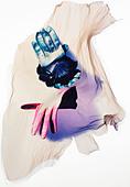Polaroid emulsion transfer of gloves. - Stock Image - BTHT4F