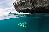 Scuba Diver in Shallow, Raja Ampat, West Papua, Indonesia - Stock Image - BM4KC3