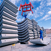 Workers stacking pre-cast steel reinforced concrete  segments used to line a tunnel on the Lesotho Highlands Water Project - Stock Image - ANE9CD