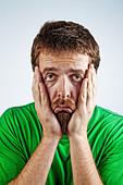 Portrait of sad unhappy bored depressed man - Stock Image - BJ1CEW