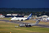 Airbus A380-841 and Airbus A400M Atlas at Farnborough International Airshow 2014 - Stock Image - E7CW4F