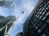 Airplane Flying Over the Broadgate Tower Skyscraper and Office Block in the Financial District, Bishopsgate, London, England, UK - Stock Image - D97DWG