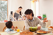 Family of Four Having Lunch - Stock Image - C3XE0H