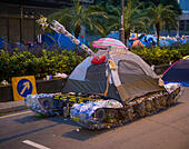 Hong Kong. 24th Oct, 2014. Students, pro democracy activists and other supporters of Occupy Central, now called the umbrella movement or the umbrella revolution, remain in the main Tamar protest site also called umbrella square or umbrella plaza. An artist who participated in Tianamen Square has created a tank from a tent and recycled water bottles. - Stock Image - E9BRGB