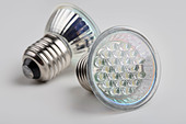 A pair of LED bulb lights with standard E27 Edison screw connector - Stock Image - ANXFNX