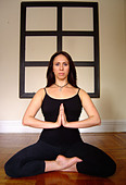 Portrait of Woman in Lotus Yoga Pose - Stock Image - AM9T59