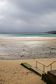 A deserted tranquil beach on a moody day, St Ives, Cornwall. - Stock Image - C7RM1G