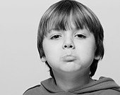 Portrait of a young boy, sulking - Stock Image - C5NCDG