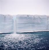 Waterfall from ice mass - Stock Image - BAARNH