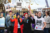London, UK. 24th Nov, 2014. NHS staff on strike across UK, St George's Hospital, Tooting, South London, UK Picture shows NHS staff on strike today outside St George's Hospital in Tooting, South London, UK Pictured (l-r)  (arms up) Trish Hamm, Matt Andrews, Laura Mundy and Rachel Williams, all Radiographers at St George's Hospital, Tooting, UK © Jeff Gilbert/Alamy Live News - Stock Image - EB1F0T