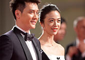"Venice, Lido of Venice. 6th Sep, 2014. Actress Tang Wei (R) and actor Feng Shaofeng pose on the red carpet for the awards ceremony at the 71st Venice Film Festival, in Lido of Venice, Italy on Sept. 6, 2014. ""The Golden Era"" directed by Ann Hui was screened as the closing film for the festival. © Liu Lihang/Xinhua/Alamy Live News - Stock Image - E74JWR"