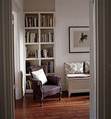 Living room interior with modern stylish bookselves armchair and painting - Stock Image - AR762G