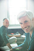 Gay couple relaxing together with record player - Stock Image - ECXGDK