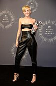 epa04367080 Us singer Miley Cyrus holds her award for Video of the Year for 'Wrecking Ball' in the pressroom for the 31st MTV Video Music Awards at The Forum in Inglewood, California, USA, 24 August 2014.  EPA/MIKE NELSON - Stock Image - E6NEJ9