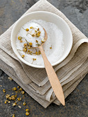 Natural bath salts with dried camomile flowers - high end Hasselblad 61mb digital image - Stock Image - ABBYRE