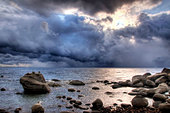 A huge storm moves over Lake Tahoe creating dramatic and moody light, Nevada. - Stock Image - C32TGR