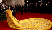 New York, New York, USA. 4th May, 2015. RIHANNA arrives wearing a yellow fur-trimmed, embroidered cape on the red carpet at the Met Gala on Monday evening for the Costume Institute Gala Benefit 'China: Through the Looking Glass.' © Nancy Kaszerman/ZUMAPRESS.com/Alamy Live News - Stock Image - ENH3F3