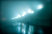 Mysterious figure walking on a wet foggy night. - Stock Image - C1RR6H