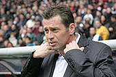 Coach Michael Skibbe of Frankfurt straightens his collar during a Bundesliga game of FC Schalke 04 versus Eintracht Frankfurt at the Commerzbank Arena in Frankfurt, Germany, 23 October 2010. Photo: Alfred Harder - Stock Image - D527PN