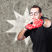 Regular guy punching and working up a sweat with boxing gloves on during a bootcamp fitness workout. Pow background - Stock Image - DTKMDJ