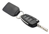 a car key and fob with shallow depth of field on white with clipping path - Stock Image - CNM1YY