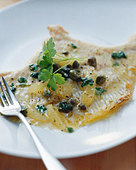 Skate fillet with caper and lemon butter - Stock Image - BD52CA