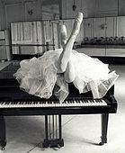 Ballerina on the Piano - Stock Image - A744AA
