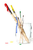 Paint brushes covered in paint - Stock Image - D92J1B