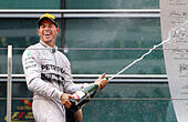 Shanghai, China. 20th Apr, 2014. Mercedes AMG Petronas British driver Lewis Hamilton celebrates with champagne on the podium after winning the the Formula One Chinese Grand Prix in Shanghai, east China, on April 20, 2014. © Fan Jun/Xinhua/Alamy Live News - Stock Image - DYJW7B