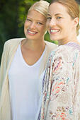 Women smiling together outdoors - Stock Image - E59TPF