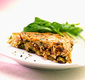 A piece of potato rösti with nuts - Stock Image - BJK8P6