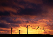 Wind turbines against moody sky - Stock Image - BM29JH