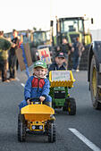 Bridgwater, UK. 27th August, 2015. Rosie, 3 and Charlie Nancekivell, 7 from Ottery St Mary, at the dairy farming protest on their toy tractors with homemade Red Tractor signs outside the Morrisons distribution depot in Bridgwater (with their parents who are dairy farmers). © Michael Scott/Alamy Live News - Stock Image - F15K0A