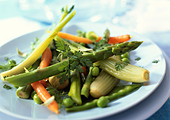 Plate of spring vegetables, close-up - Stock Image - AWMJ5F
